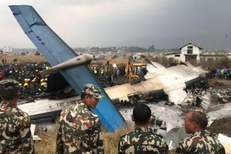 Pictures: Passenger plane crashes, catches fire at Kathmandu airport