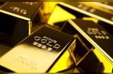 الذهب يتراجع عند التسوية مع ارتفاع الدولار