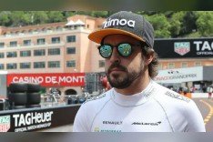 Real Madrid fan Fernando Alonso prepared to face the wrath of Liverpool-supporting McLaren crew before Monaco GP