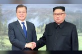 Leaders of Koreas hold surprise meeting as Trump revives hopes of summit