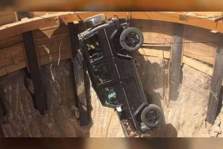 Dubai Police rescue man after his car falls into pit