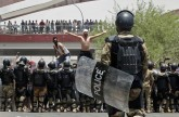 Iraq police fire in air as protesters try to storm Basra government building